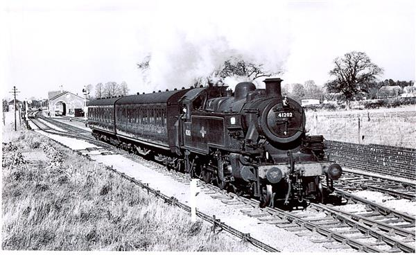 a black and white picture of a train